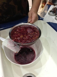 straining muscadine juice